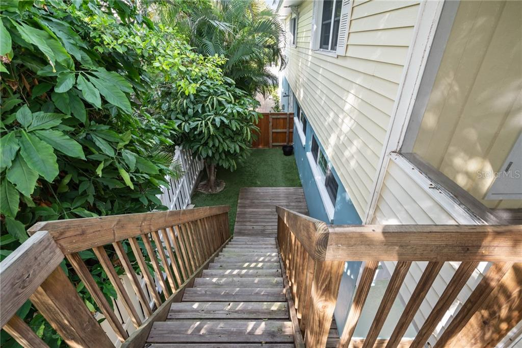 Second Floor Stairs Leading into the Backyard - Single Family Home for sale at 107 Willow Ave, Anna Maria, FL 34216 - MLS Number is A4421946