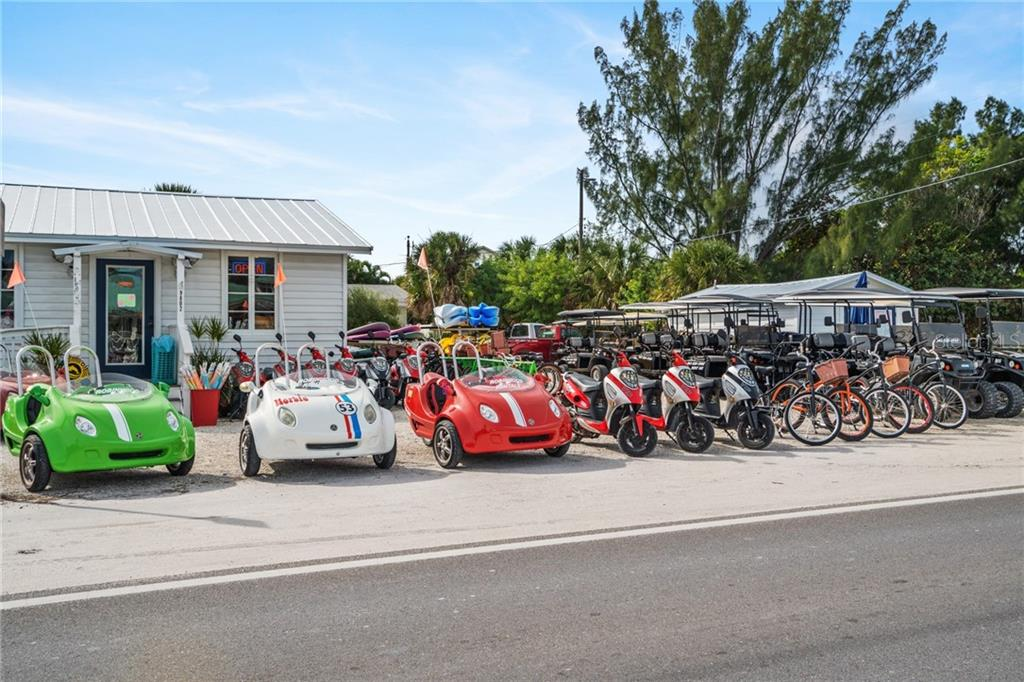 Rent Buggies, Scooters, and Bikes at AMI Beach Buggy's - Single Family Home for sale at 107 Willow Ave, Anna Maria, FL 34216 - MLS Number is A4421946