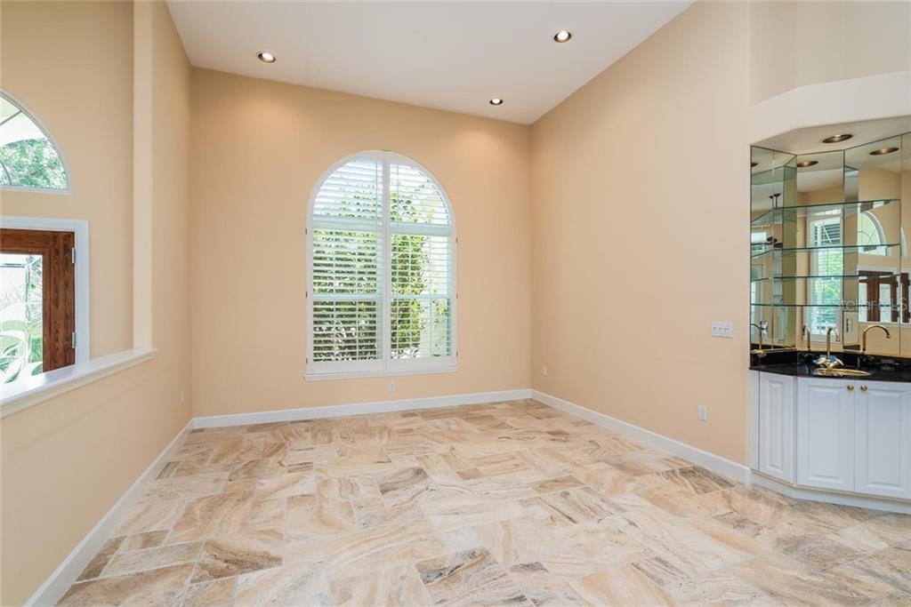 Formal dining area with wet bar - Single Family Home for sale at 3640 Flamingo Ave, Sarasota, FL 34242 - MLS Number is A4422130