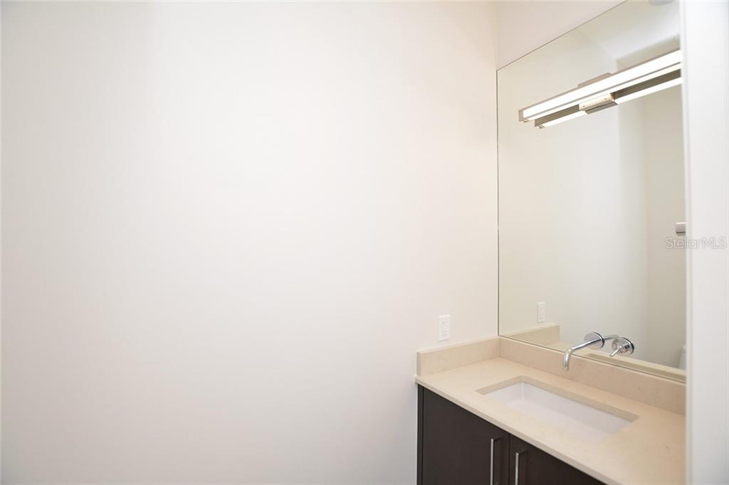 Powder room off the main living area hallway. - Condo for sale at 609 Golden Gate Pt #301, Sarasota, FL 34236 - MLS Number is A4422419