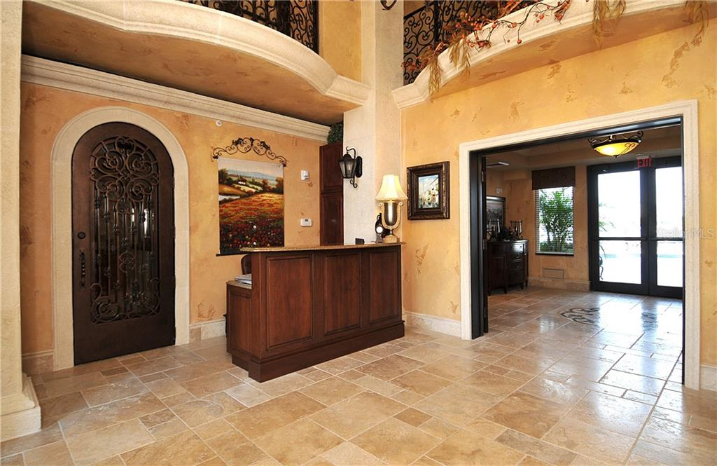 Concierge lobby area. - Condo for sale at 464 Golden Gate Pt #701, Sarasota, FL 34236 - MLS Number is A4422622