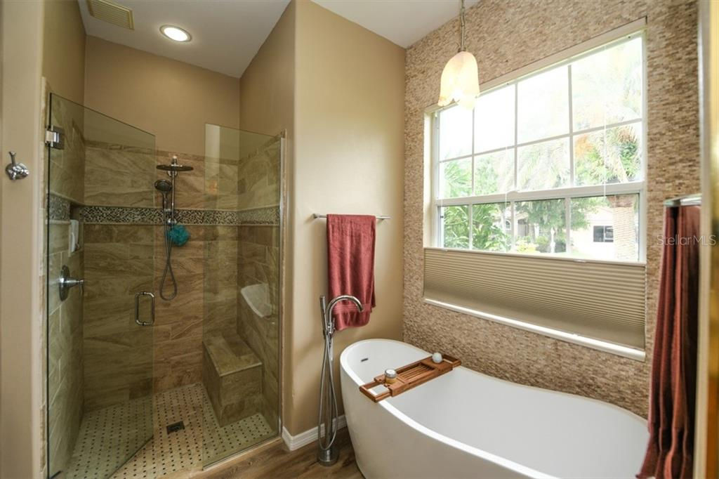 Master bath shower with seat and soaking tub - Single Family Home for sale at 6161 Varedo Ct, Sarasota, FL 34243 - MLS Number is A4422883