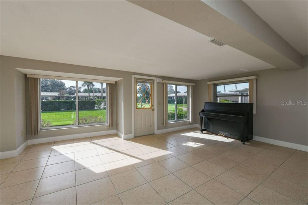 Extended living room area. - Villa for sale at 3434 Medford Ln #1110, Sarasota, FL 34239 - MLS Number is A4422897