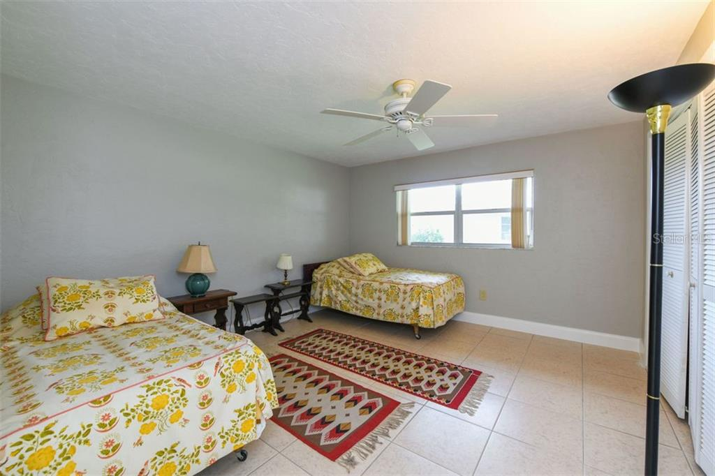 Second bedroom. - Villa for sale at 3434 Medford Ln #1110, Sarasota, FL 34239 - MLS Number is A4422897