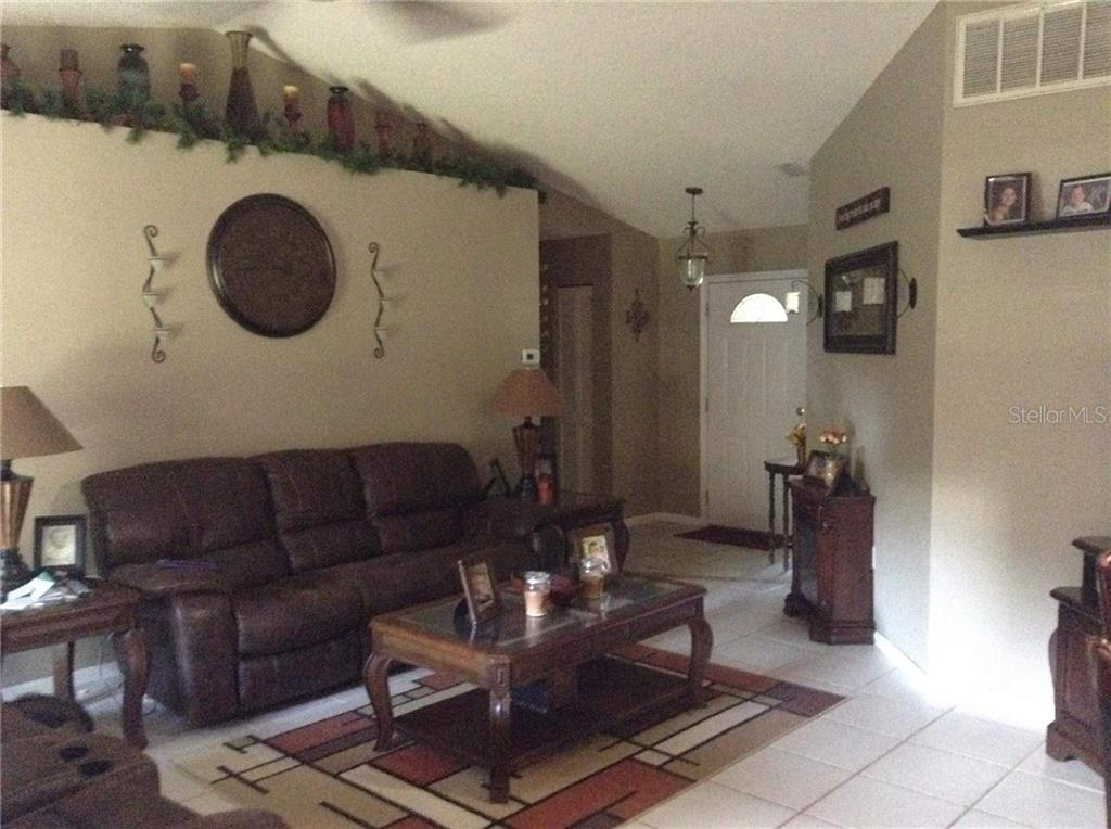 Living room - Single Family Home for sale at 6909 43rd Ct E, Sarasota, FL 34243 - MLS Number is A4423173
