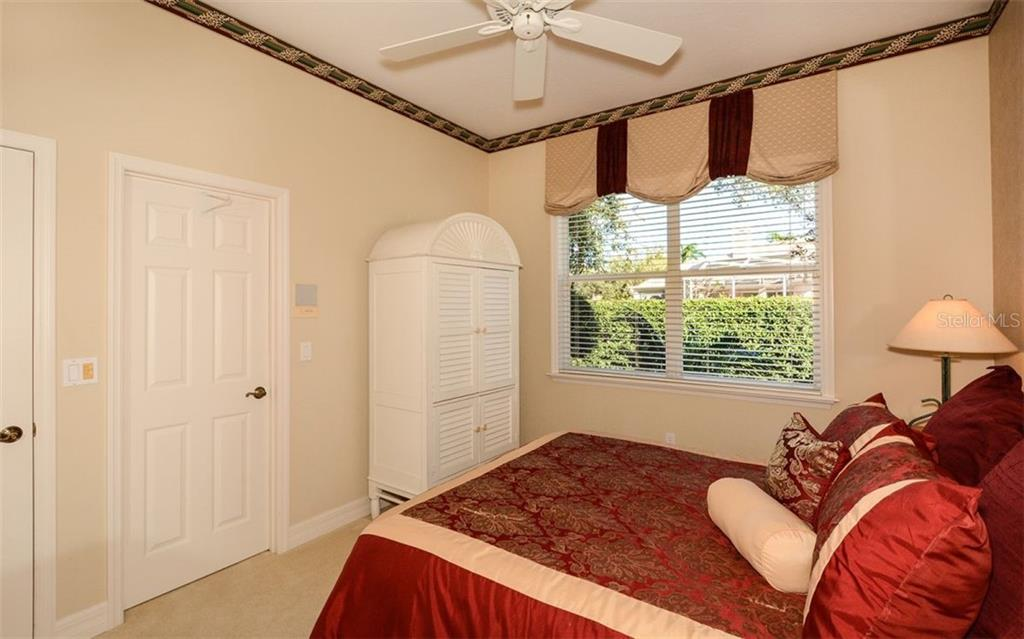 Guest Bedroom One with walk in closet - Single Family Home for sale at 2522 Tom Morris Dr, Sarasota, FL 34240 - MLS Number is A4423908