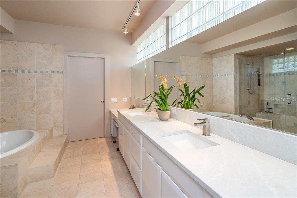 Master ensuite includes beautiful dual sinks, vanity, garden bath, large walk-in closet, private w/c, and pocket door to expansive closet! - Single Family Home for sale at 509 Venice Ln, Sarasota, FL 34242 - MLS Number is A4425092