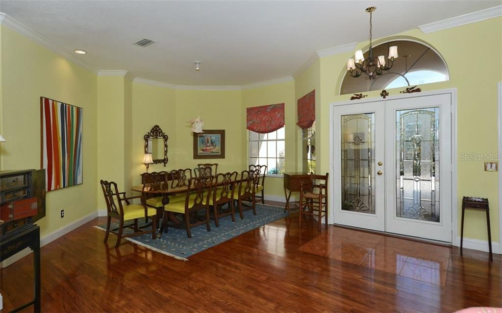 Dining room can easily accommodate a large dinner party. - Single Family Home for sale at 8926 Grey Oaks Ave, Sarasota, FL 34238 - MLS Number is A4425574