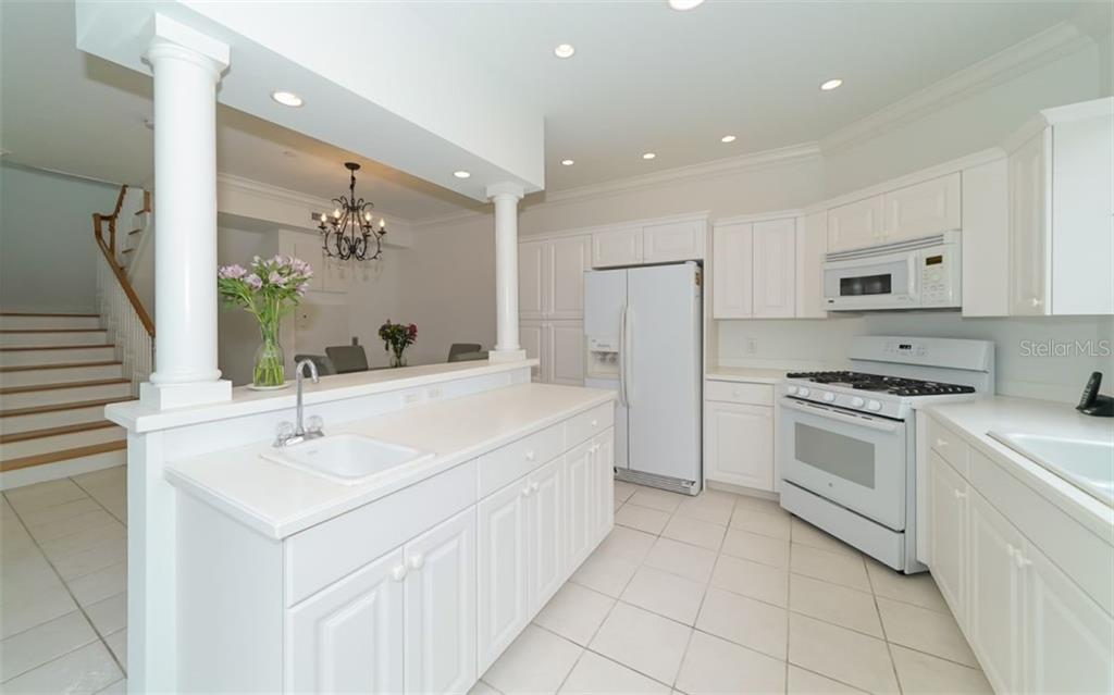 The kitchen island with prep sink - a perfect mini-bar set up. - Condo for sale at 1283 Fruitville Rd #a, Sarasota, FL 34236 - MLS Number is A4426039