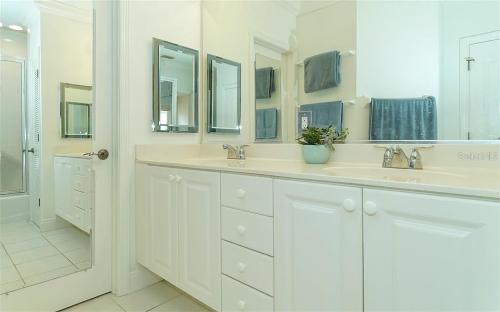 Master bath and walk-in closet beyond. - Condo for sale at 1283 Fruitville Rd #a, Sarasota, FL 34236 - MLS Number is A4426039