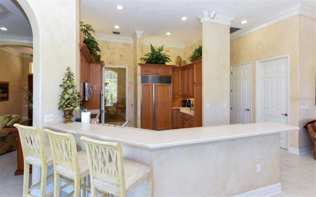 Breakfast Bar for six facing the Open Kitchen. - Single Family Home for sale at 561 Ketch Ln, Longboat Key, FL 34228 - MLS Number is A4426280