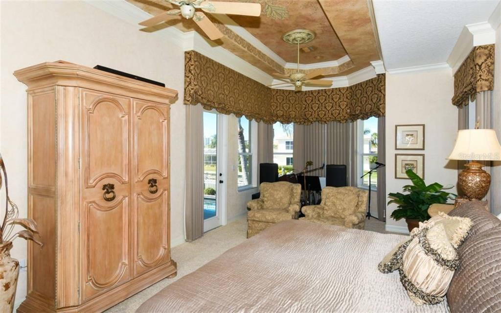 Sitting Area by windows and door with views of the pool, canal, and Sarasota Bay. - Single Family Home for sale at 561 Ketch Ln, Longboat Key, FL 34228 - MLS Number is A4426280