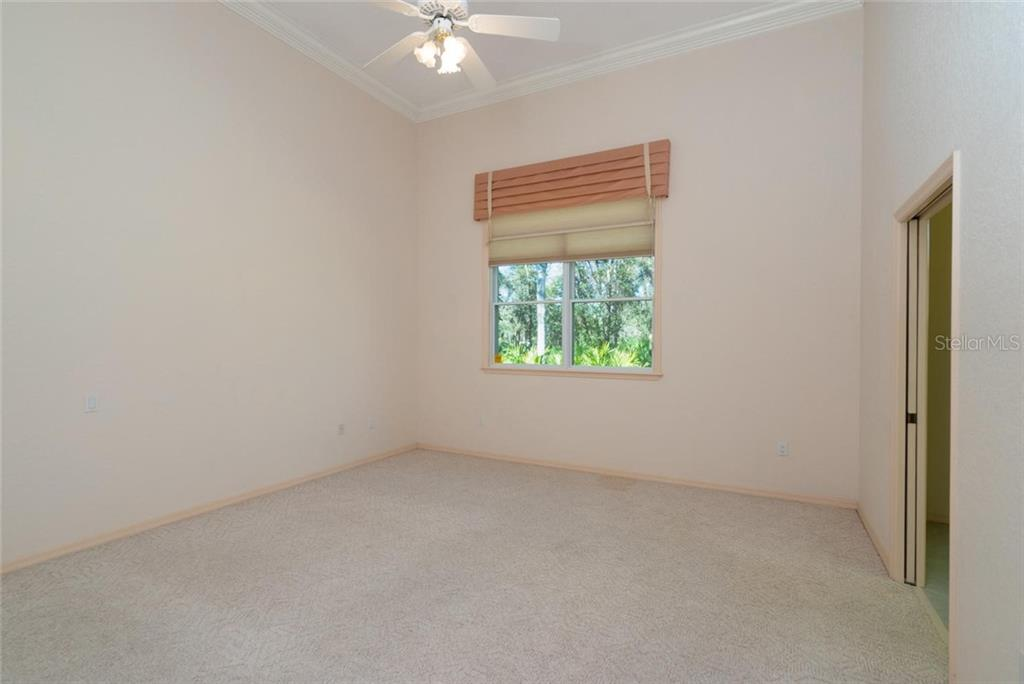 Guest suite Two with a private en-suite and walk-in closet! - Single Family Home for sale at 4931 Ashley Pkwy, Sarasota, FL 34241 - MLS Number is A4426972