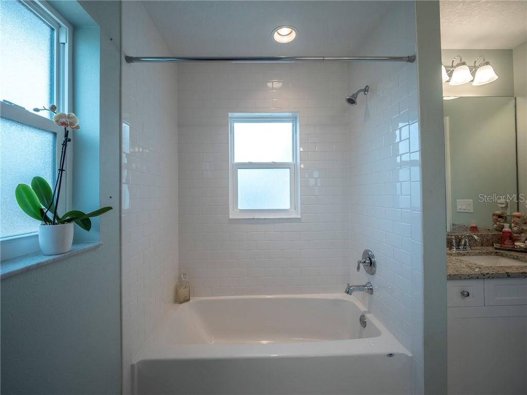 Guest bathroom with subway tile bathtub - Single Family Home for sale at 3611 4th Ave Ne, Bradenton, FL 34208 - MLS Number is A4426978