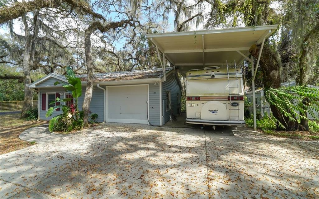 RV car port ready for your own RV or boat! - Single Family Home for sale at 2215 Shadow Wood Ln, Sarasota, FL 34240 - MLS Number is A4427846