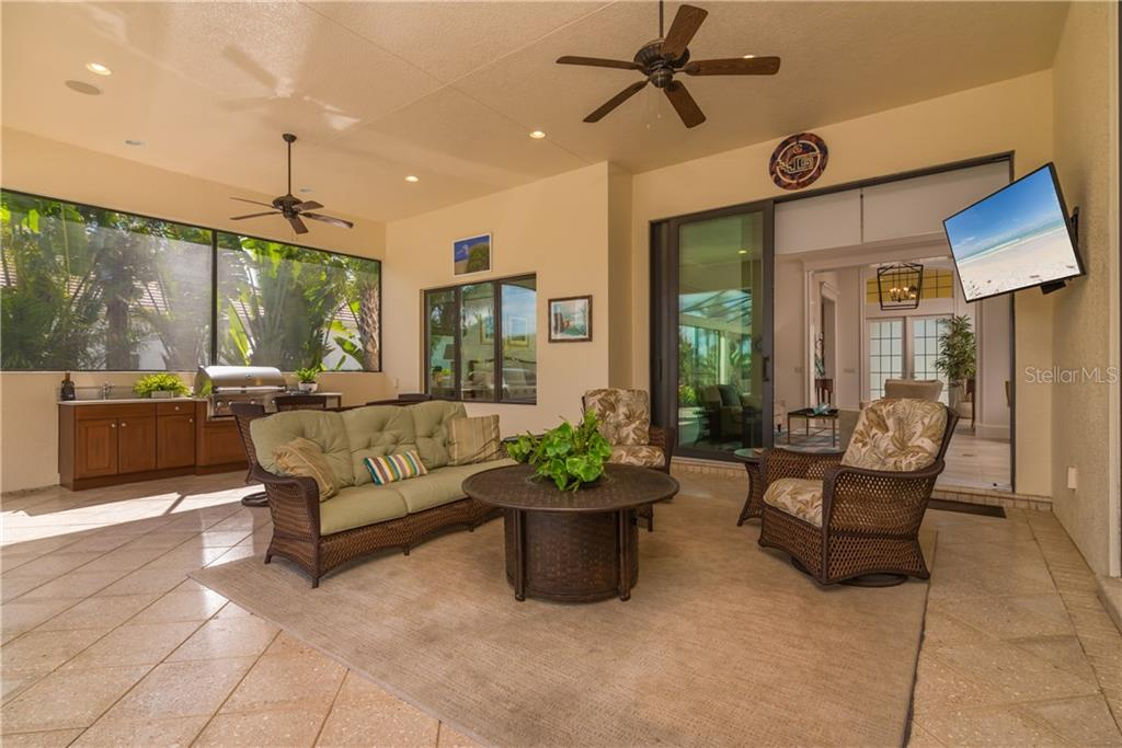 Outdoor Living/Dining and kitchen - Single Family Home for sale at 3507 Founders Club Dr, Sarasota, FL 34240 - MLS Number is A4428010