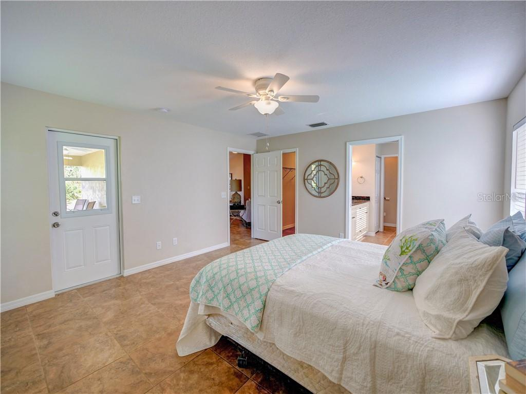 Large master suite with access to outdoor patio - Single Family Home for sale at 2558 Oneida Rd, Venice, FL 34293 - MLS Number is A4428145