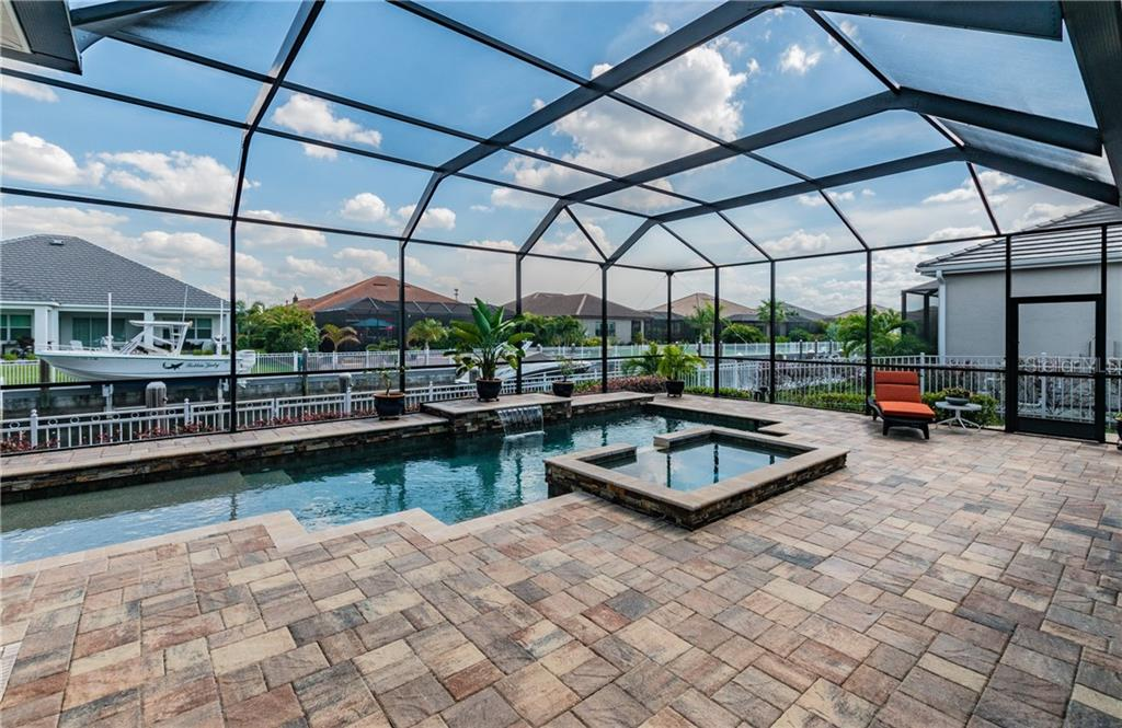 Gorgeous pavers add the luxurious touch to the outdoor space. - Single Family Home for sale at 595 Fore Dr, Bradenton, FL 34208 - MLS Number is A4428657