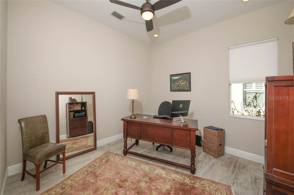 Downstairs den or office with French doors for privacy when needed. - Single Family Home for sale at 5504 Tidewater Preserve Blvd, Bradenton, FL 34208 - MLS Number is A4429479