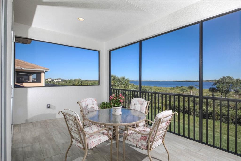 Upstairs balcony lanai overlooking a fork in the Manatee River - Single Family Home for sale at 5504 Tidewater Preserve Blvd, Bradenton, FL 34208 - MLS Number is A4429479