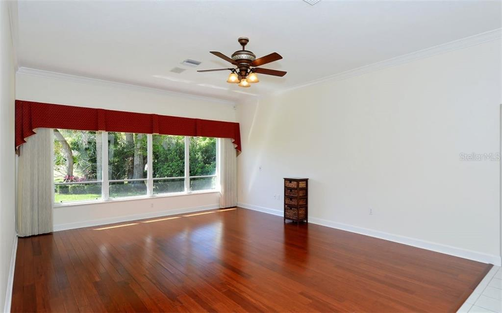 This family room offers extra space for a large TV to entertain guests - Single Family Home for sale at 1636 Liscourt Dr, Venice, FL 34292 - MLS Number is A4429524