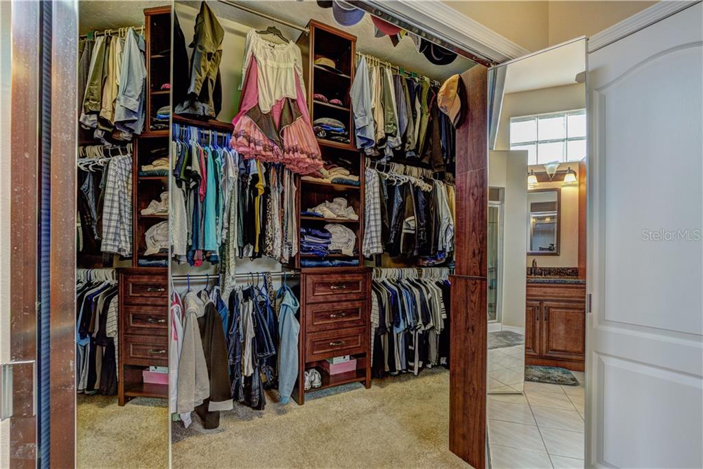 Custom built his/her cherry wood walk-in closet with huge storage capacity - Single Family Home for sale at 6321 W Glen Abbey Ln E, Bradenton, FL 34202 - MLS Number is A4429610
