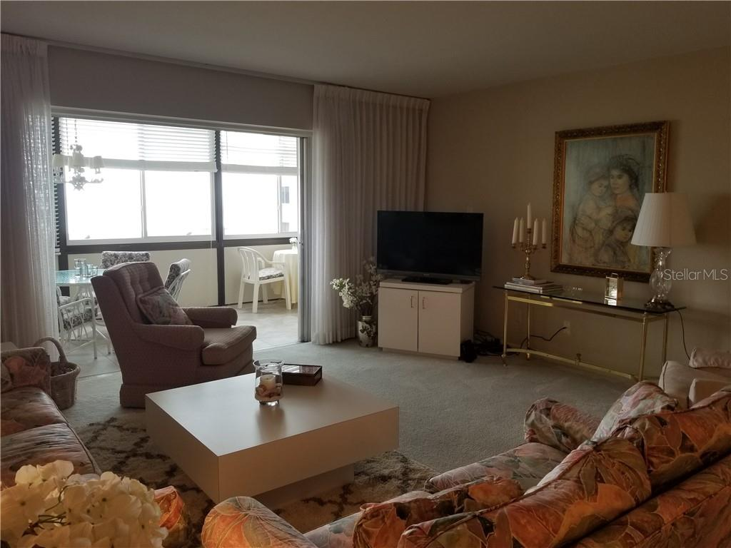 Living room with pocket sliders to lanai - Condo for sale at 1125 W Peppertree Dr #603, Sarasota, FL 34242 - MLS Number is A4430690
