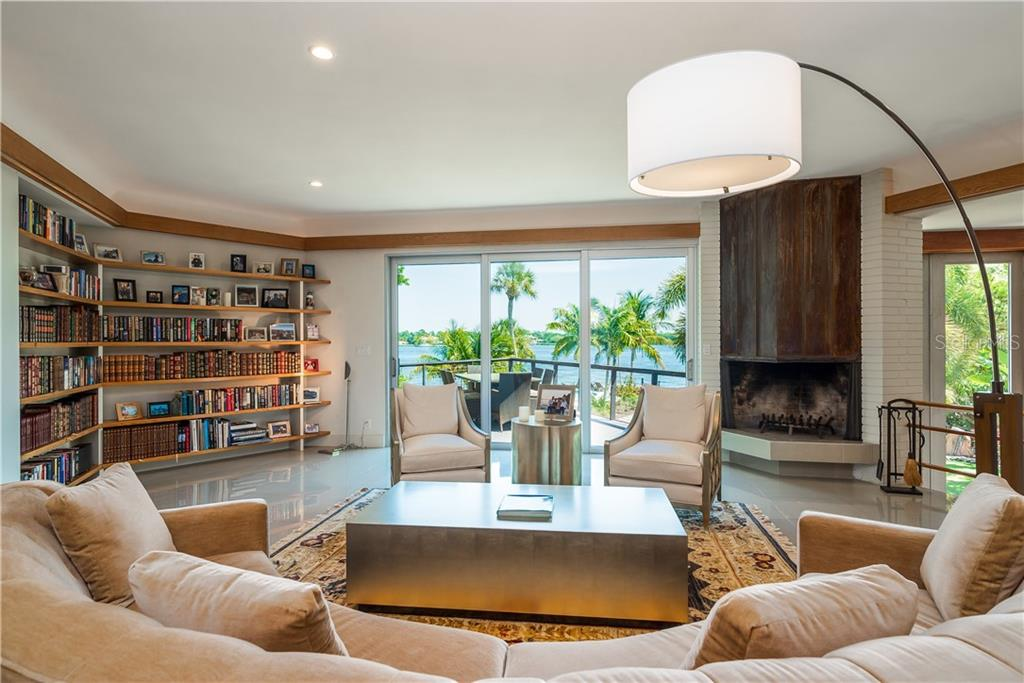 Living room with large open bay views. - Single Family Home for sale at 6841 Peacock Rd, Sarasota, FL 34242 - MLS Number is A4430828