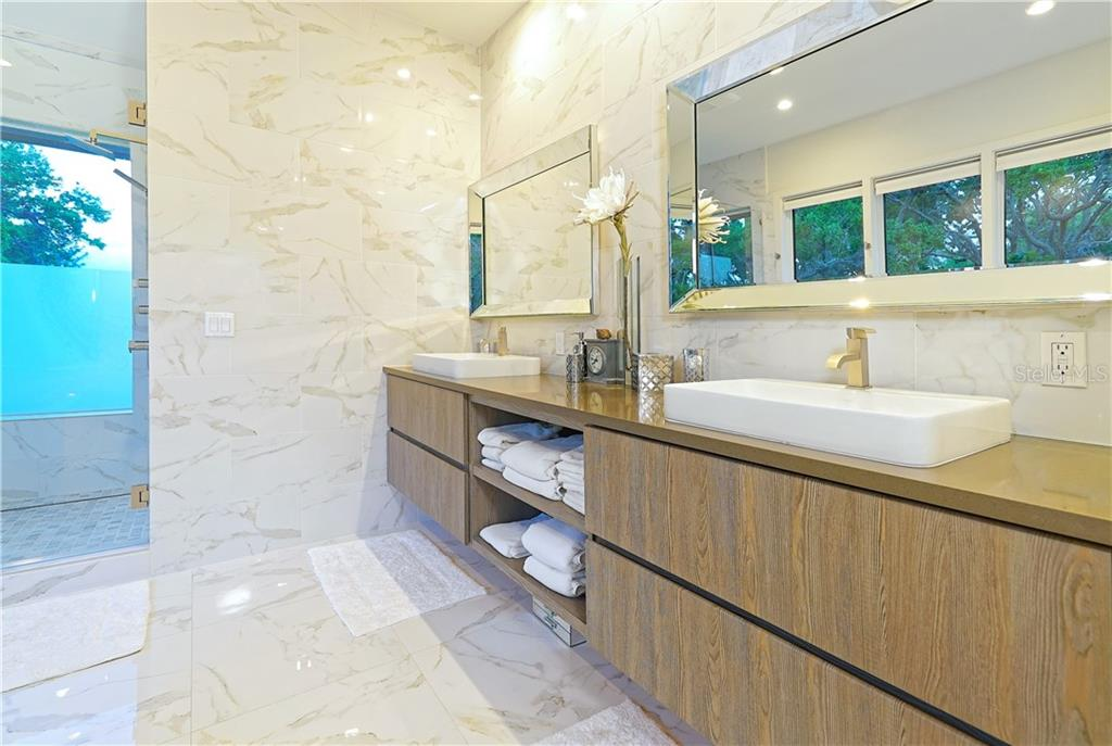 Master bath with dual sinks. - Single Family Home for sale at 6841 Peacock Rd, Sarasota, FL 34242 - MLS Number is A4430828