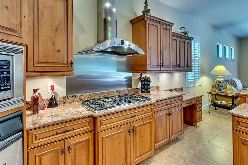 Chef kitchen with gas stove top - Single Family Home for sale at 3753 Eagle Hammock Dr, Sarasota, FL 34240 - MLS Number is A4431001