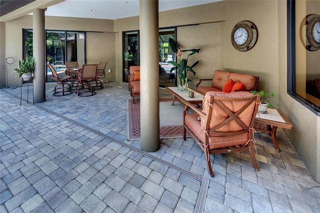 Separate entertaining spaces in lanai - Single Family Home for sale at 3753 Eagle Hammock Dr, Sarasota, FL 34240 - MLS Number is A4431001