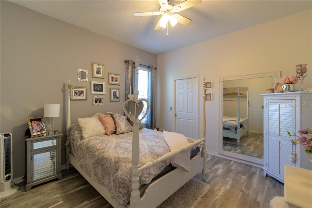 Guest bedroom with sliders out to back yard - Single Family Home for sale at 29215 Saddlebag Trl, Myakka City, FL 34251 - MLS Number is A4431037