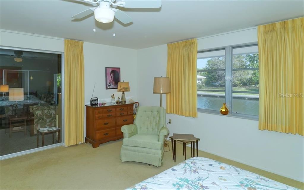 Master Bedroom with Views of the Canal - Single Family Home for sale at 935 Contento St, Sarasota, FL 34242 - MLS Number is A4431223