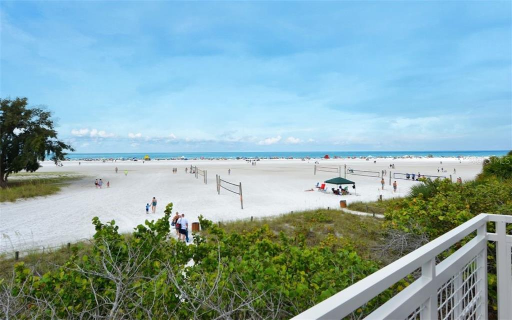 Relaxing fun at Siesta Beach or enjoy a game of Beach volleyball! - Single Family Home for sale at 935 Contento St, Sarasota, FL 34242 - MLS Number is A4431223