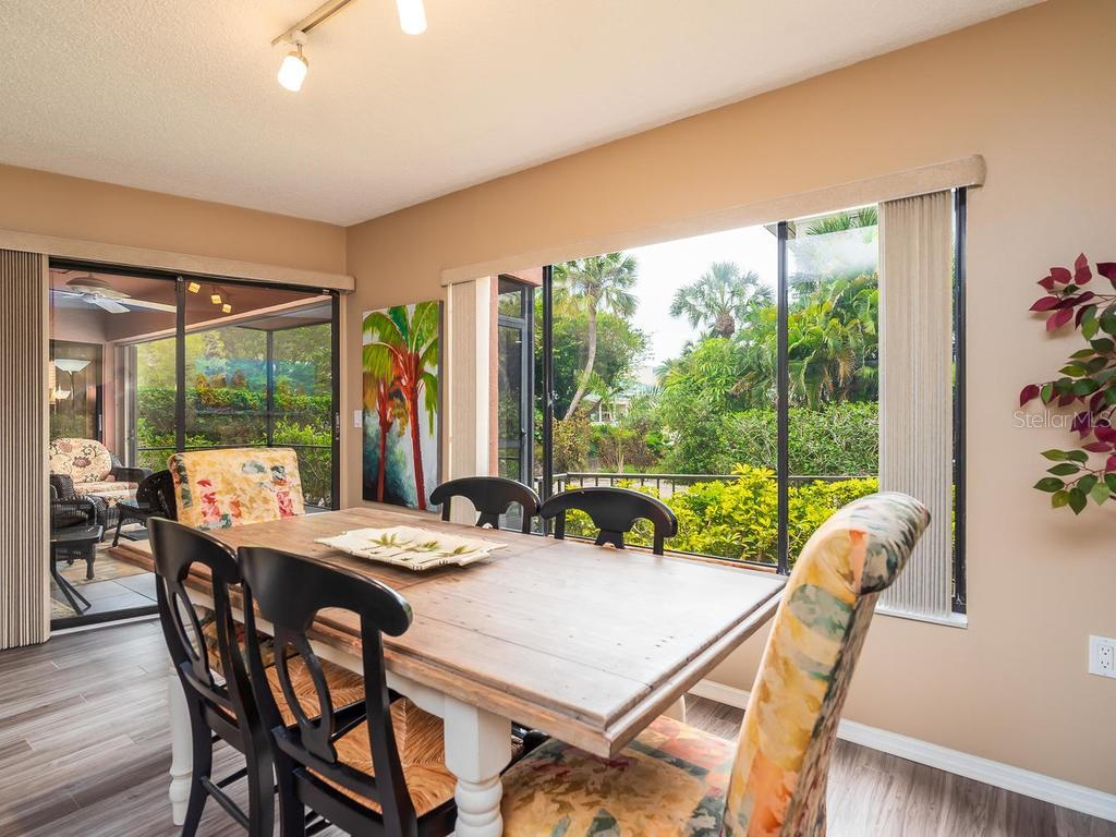 Generous dining area looking out to the tropical surroundings - Condo for sale at 131 Garfield Dr #1b, Sarasota, FL 34236 - MLS Number is A4432013