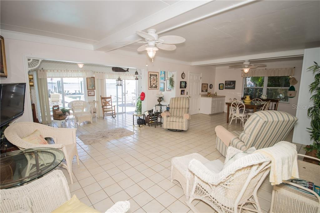 First Level Great Room perfect for entertaining.  Goes directly to pool and waterfront. - Single Family Home for sale at 2405 Avenue A, Bradenton Beach, FL 34217 - MLS Number is A4433128