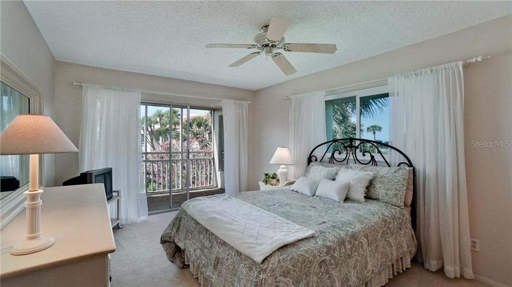 Master bedroom with view of Gulf, lovely landscaped grounds, beach to the north. - Condo for sale at 7145 Gulf Of Mexico Dr #24, Longboat Key, FL 34228 - MLS Number is A4433880