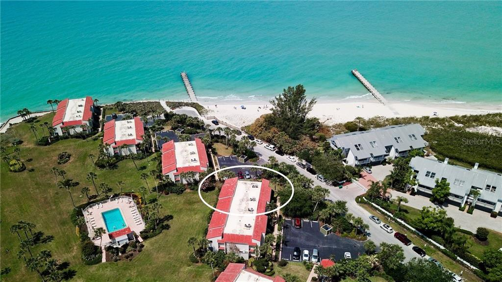 SandDollar building in Longbeach Condominium Complex located on corner of North Shore Road & Joy Street. Public beach entry steps away. Two recently installed groins off beach to help keep beach sand intact. - Condo for sale at 7145 Gulf Of Mexico Dr #24, Longboat Key, FL 34228 - MLS Number is A4433880