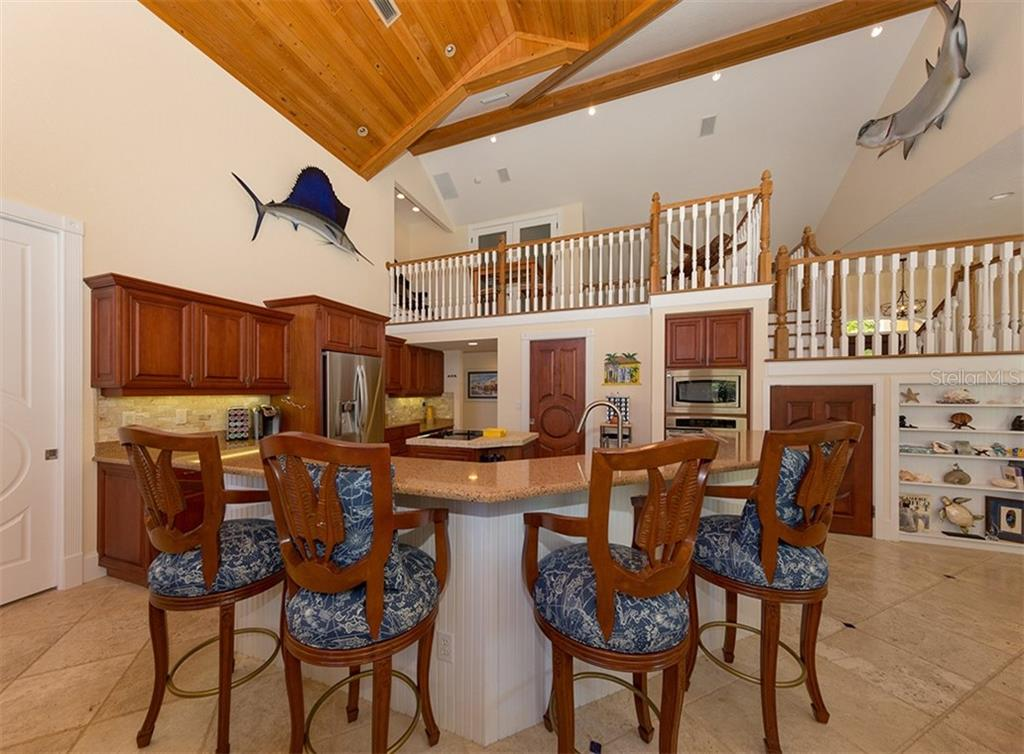 Breakfast bar, kitchen - Single Family Home for sale at 1361 Bayshore Dr, Englewood, FL 34223 - MLS Number is A4433943