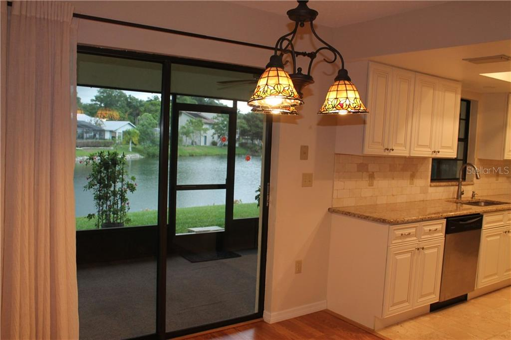 Dining room over looking the 65 foot frontage of the pond. - Single Family Home for sale at 4803 Glenbrooke Dr, Sarasota, FL 34243 - MLS Number is A4435920