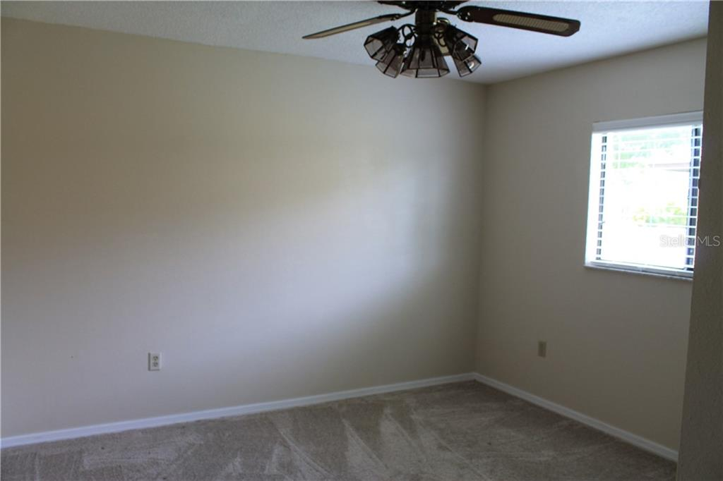 Second bedroom 11x12 feet.  Carpet is in great shape at 2 years old. - Single Family Home for sale at 4803 Glenbrooke Dr, Sarasota, FL 34243 - MLS Number is A4435920