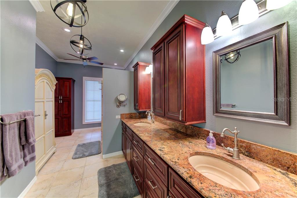 Master bathroom, with dual sinks and over-sized shower. - Single Family Home for sale at 1202 N View Dr, Sarasota, FL 34242 - MLS Number is A4436092