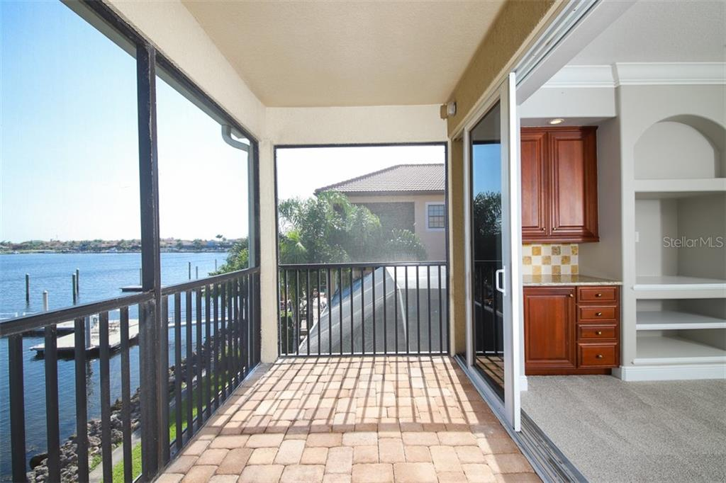 Second floor game room with its own screened terrace with zero corner sliding doors - Single Family Home for sale at 902 Riviera Dunes Way, Palmetto, FL 34221 - MLS Number is A4436277