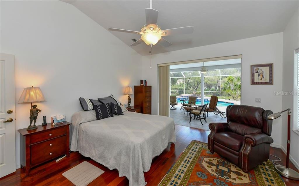 Master open to lanai and pool; note volume ceilings! - Single Family Home for sale at 5401 Downham Meadows, Sarasota, FL 34235 - MLS Number is A4436577