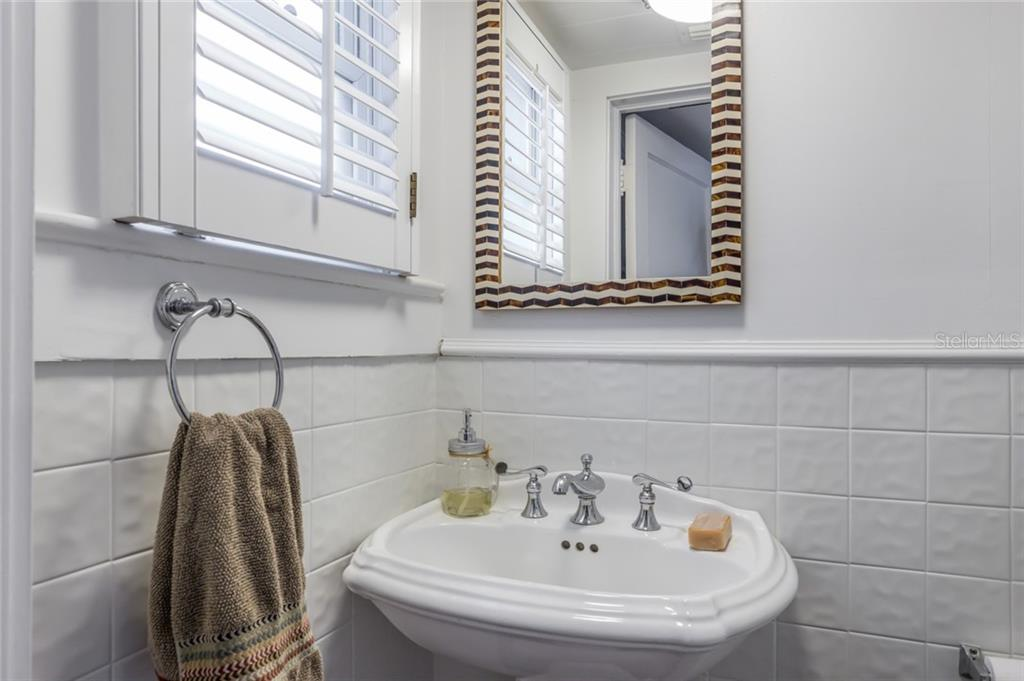 First floor powder room. - Single Family Home for sale at 590 Bayshore Dr, Terra Ceia, FL 34250 - MLS Number is A4437024