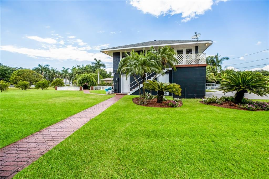 Carriage house/guest cottage has oversized 2 car garage, full bath and laundry on the first floor. - Single Family Home for sale at 590 Bayshore Dr, Terra Ceia, FL 34250 - MLS Number is A4437024