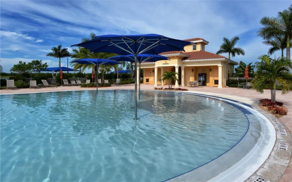 Poolside seating - Single Family Home for sale at 13337 Pacchio St, Venice, FL 34293 - MLS Number is A4437569