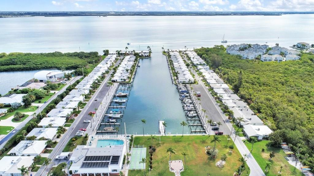 Aerial Marina, Clubhouse and pool - Villa for sale at 717 Spanish Dr N, Longboat Key, FL 34228 - MLS Number is A4438337