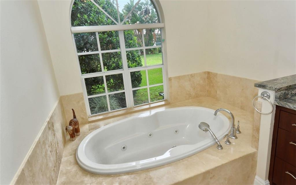 Custom walnut cabinetry, spa tub with handheld shower. - Single Family Home for sale at 6301 Thorndon Cir, University Park, FL 34201 - MLS Number is A4438968