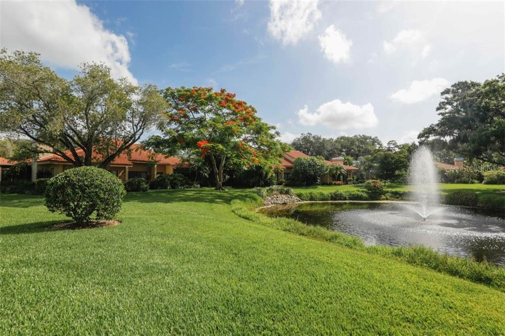 Flame tree & fountain - Condo for sale at 1742 Landings Blvd #38, Sarasota, FL 34231 - MLS Number is A4439252